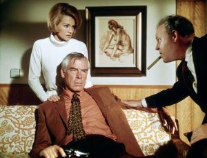 Walker is framed by his last victim, Brewster, and the woman he uses to get his vengeance, Chris. © 1967 – MGM. All Rights Reserved.